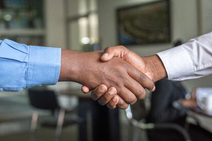 handshake unsplash cytonn-photography